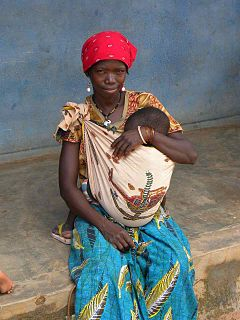 240px-VillageReach_-_mother_and_child_outside_clinic